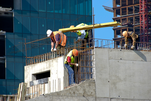 Florida General Contractor Employees Constructing a Multi-Story Building